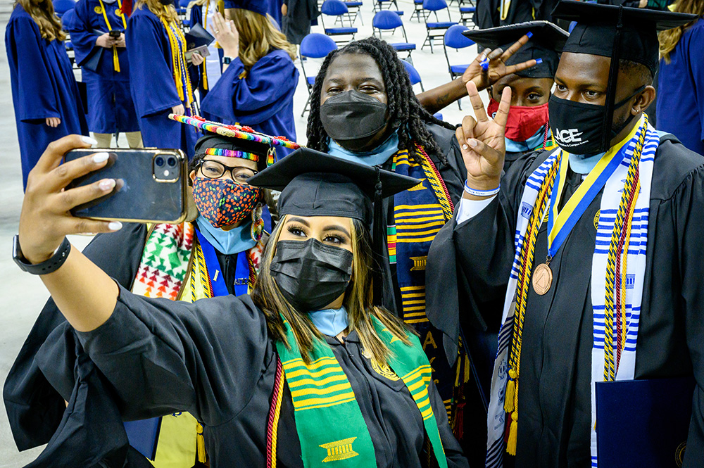 Graduates taking a selfie during May 2021 Commencement